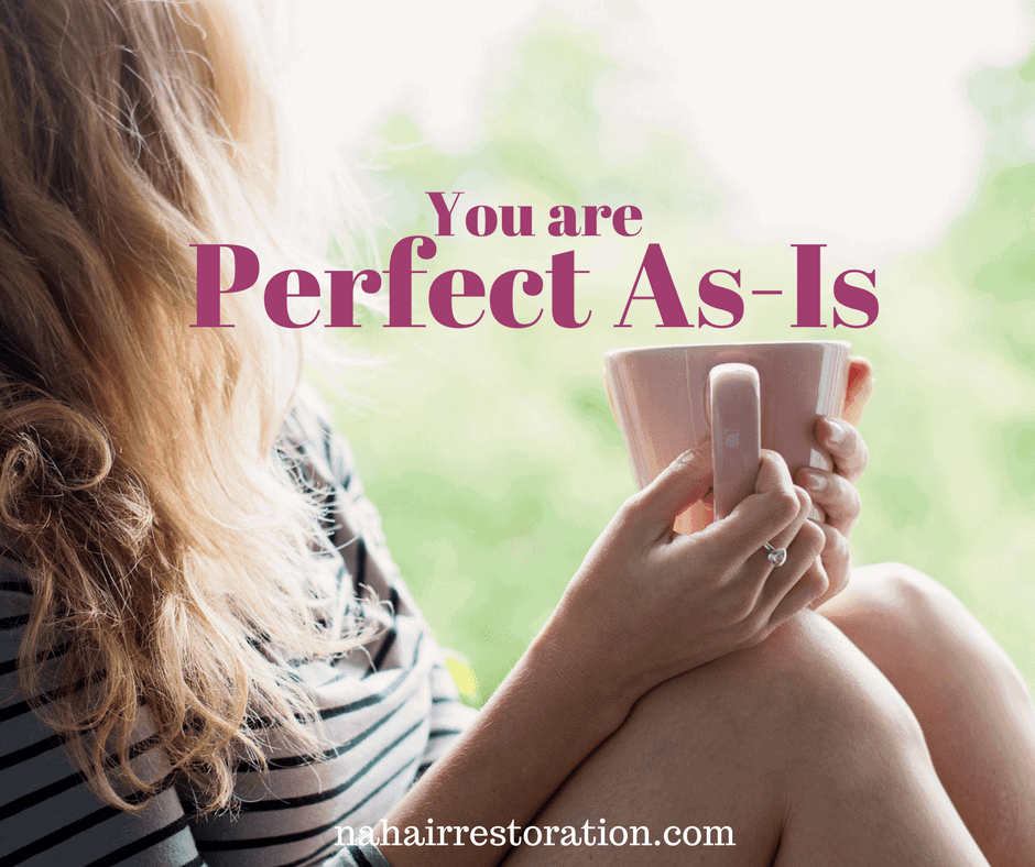 Girl sitting on the left side holding a cup. With text. * YOU ARE PERFECT AS-IS*