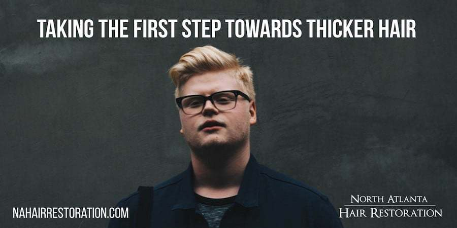 "a guy wearing a black-framed clear eyeglasses in a gray background with the text, ""TAKING THE FIRST STEP TOWARDS THICKER HAIR"""