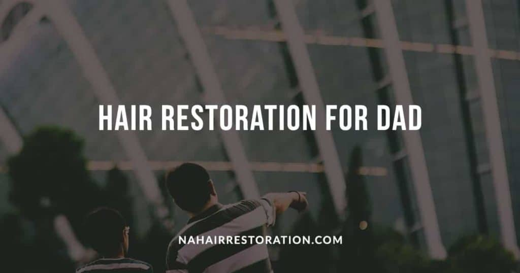 """a man with his son wearing the same stripe-designed shirt pointing in front of the buildings with the text, """"HAIR RESTORATION FOR DAD"""""""