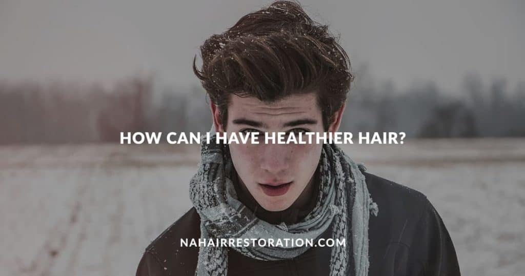 "a man with scarf in the snowy street background with the text, ""HOW CAN I HAVE HEALTHIER HAIR?"""